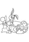 Dibujo para colorear Conejito de pascua con huevos de pascua