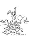 Dibujo para colorear Conejito de Pascua en canasta de Pascua
